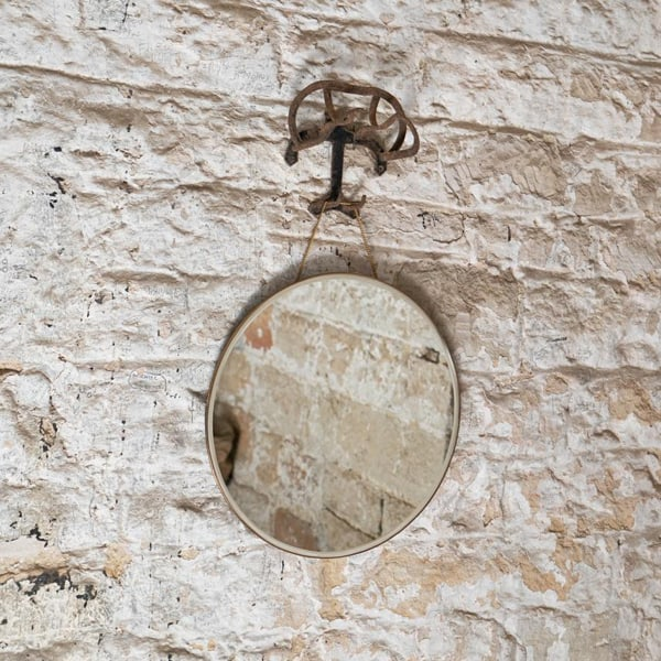porthole-mirror-on-stone