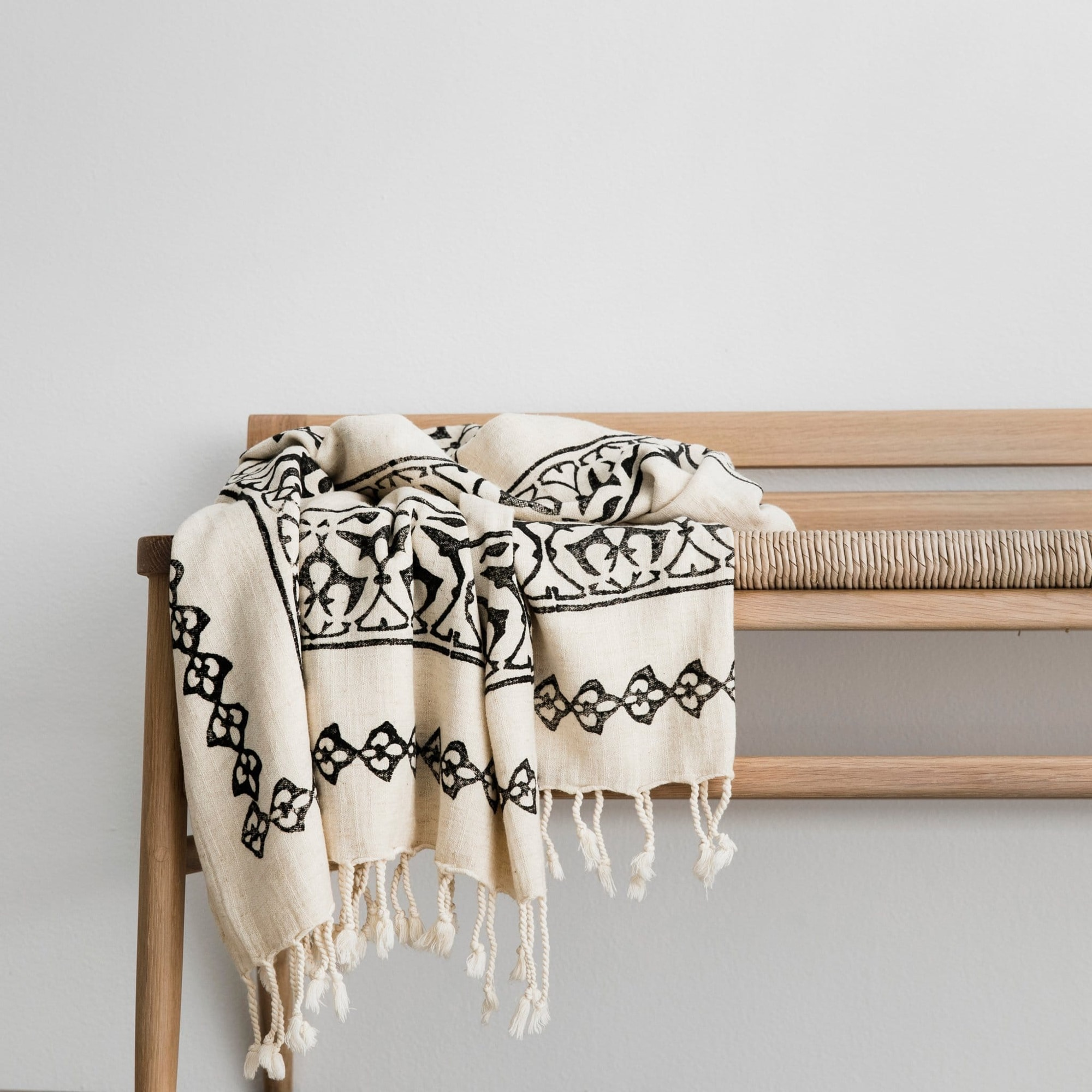 Isobel throw draped on bench seat from Monsoon Living Newcastle