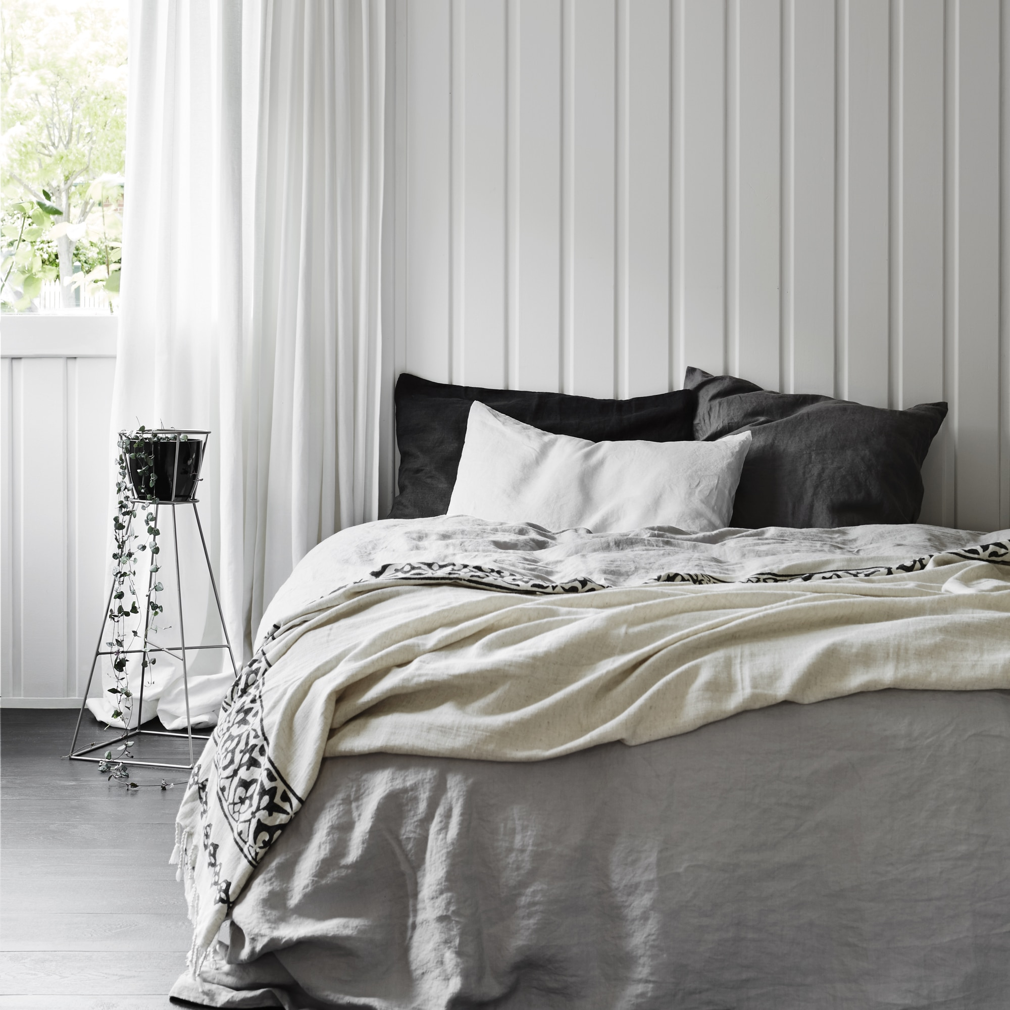 Isobel throw styled across the end of the bed from Monsoon Living Newcastle