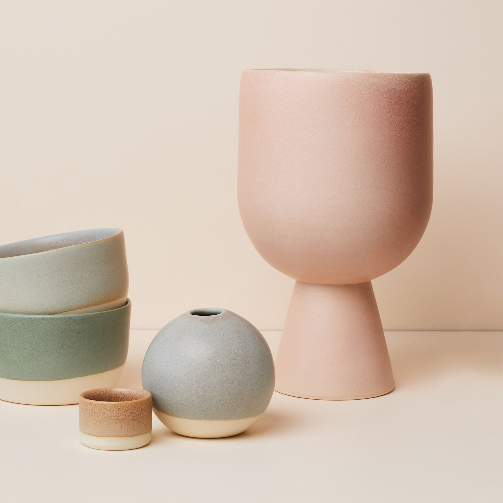 Ceramic vase and planter in a blush glaze with bowls from Monsoon Living Newcastle