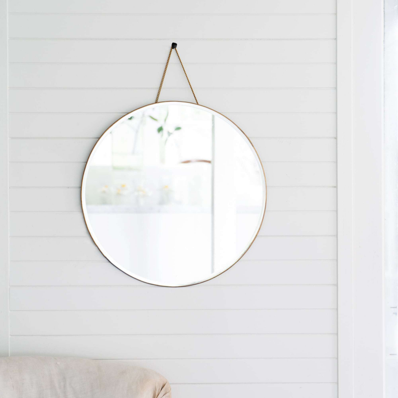 Brass porthole mirror on white wall from Monsoon Living Newcastle