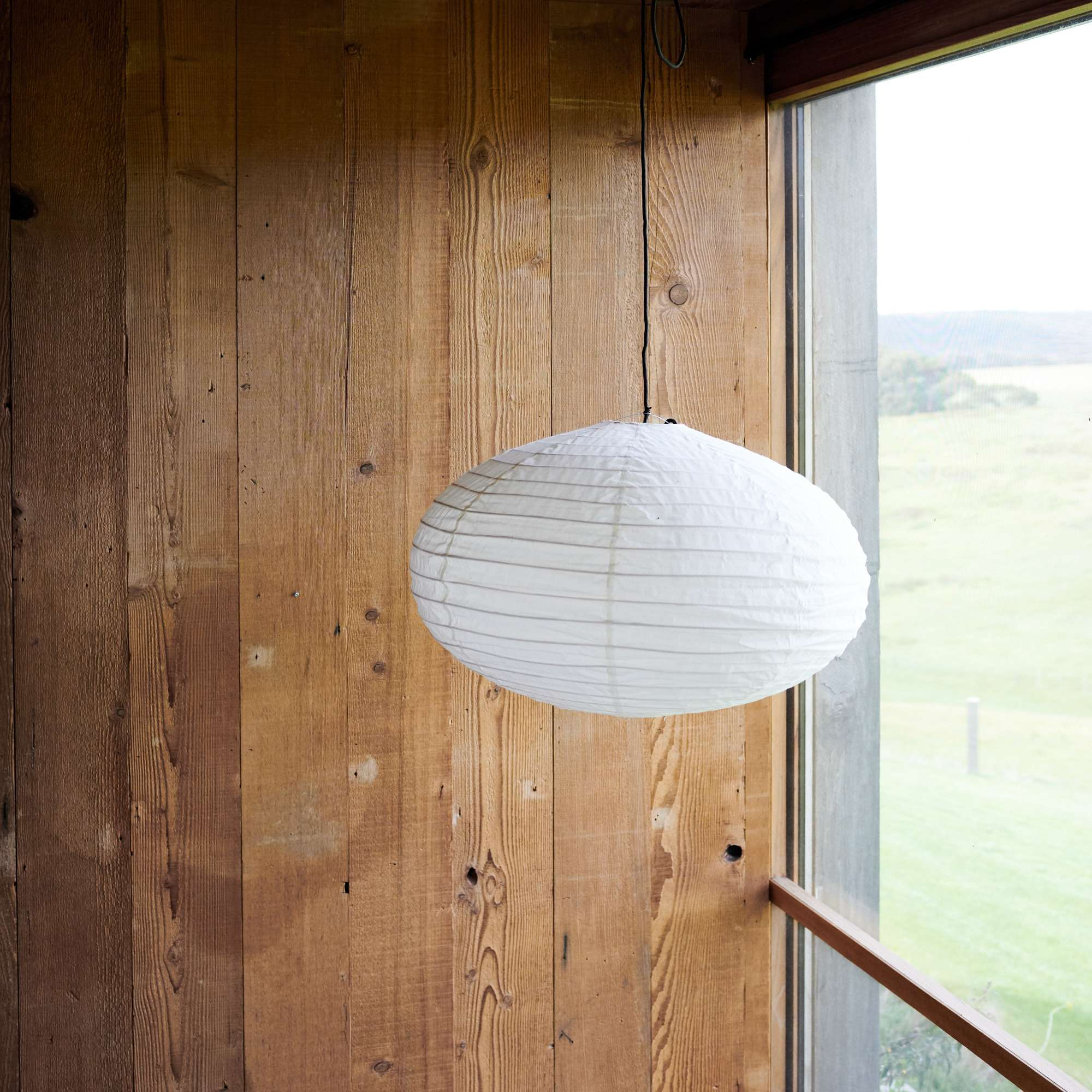 Dampier Lantern against timber wall from Monsoon Living Newcastle