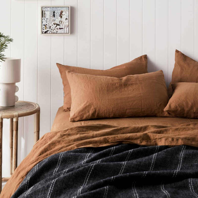 Cedar linen styled on a bed for Monsoon Living